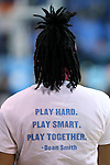 "19 February 2015: North Carolina's Hillary Fuller wears a t-shirt during the pregame with a quote from recently deceased UNC coaching legend Dean Smith reading, ""Play Hard. Play Smart. Play Together."" The University of North Carolina Tar Heels hosted the Wake Forest University Demon Deacons at Carmichael Arena in Chapel Hill, North Carolina in a 2014-15 NCAA Division I Women's Basketball game."