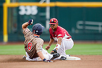 Arkansas Razorbacks shortstop Michael Bernal (3) tags Virginia Cavaliers baserunner Robbie Coman (8) out at second base in Game 1 of the NCAA College World Series on June 13, 2015 at TD Ameritrade Park in Omaha, Nebraska. Virginia defeated Arkansas 5-3. (Andrew Woolley/Four Seam Images)