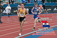 Festus senior Tyler Gilliam leads Winfield (Ks) junior Riley Osen around a curve late in the boys 3200-meters on his way to a 2nd place finish in a personal record of 9:14.78 while Osen won in 9:13.43 at the 2015 Kansas Relays.