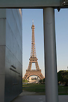 Eiffel Tower, Paris.  Shot from the Champs de Mars.  Tower is framed by the structure of the Wall for Peace.