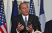 President Jacques Chirac of France makes remarks to the press after talks with United States President George W. Bush in the Oval Office of the White House in Washington, DC on November 6, 2001.  The Presidents continued their meetings over lunch in the White House Residence.<br /> Credit: Ron Sachs / CNP
