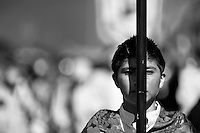 A young Catholic follower leads the annual Holy Week procession (Lavado de la cruz) in Santa Elena, Ecuador, 3 April 2012.