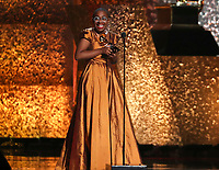 "Cecile McLorin Salvant accepts the award for best jazz vocal album for ""The Window"" at the 61st annual Grammy Awards on Sunday, Feb. 10, 2019, in Los Angeles. (Photo by Matt Sayles/Invision/AP)"