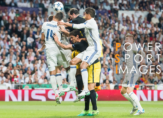 Carlos Henrique Casemiro and Raphael Varane of Real Madrid and Diego Roberto Godin Leal of Atletico de Madrid in action during their 2016-17 UEFA Champions League Semifinals 1st leg match between Real Madrid and Atletico de Madrid at the Estadio Santiago Bernabeu on 02 May 2017 in Madrid, Spain. Photo by Diego Gonzalez Souto / Power Sport Images