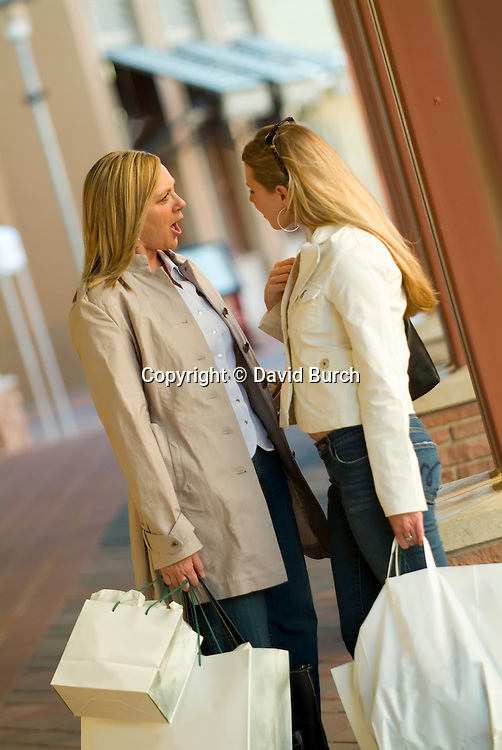 Mother and daughter, shopping and arguing