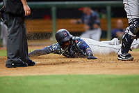 Jacksonville Jumbo Shrimp center fielder Monte Harrison (3) slides into home plate during a game against the Mobile BayBears on April 14, 2018 at Baseball Grounds of Jacksonville in Jacksonville, Florida.  Mobile defeated Jacksonville 13-3.  (Mike Janes/Four Seam Images)