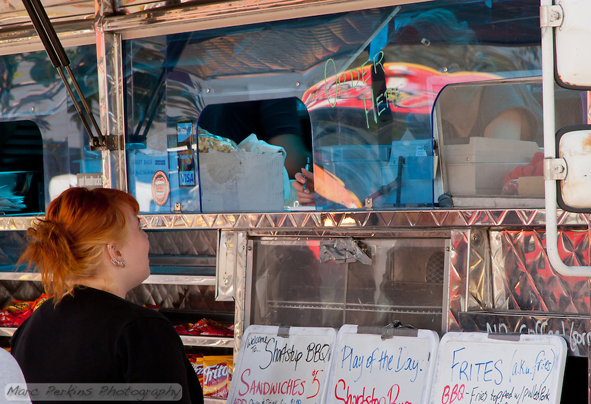 A woman orders food at Shortstop BBQ truck.