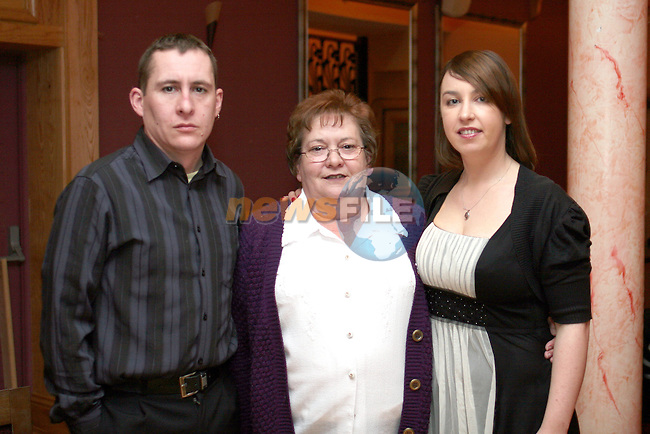 Joan Matthews with her son Paul and Elaine Black at her 60th in The Thatch...Photo NEWSFILE/Jenny Matthews.(Photo credit should read Jenny Matthews/NEWSFILE)....This Picture has been sent you under the condtions enclosed by:.Newsfile Ltd..The Studio,.Millmount Abbey,.Drogheda,.Co Meath..Ireland..Tel: +353(0)41-9871240.Fax: +353(0)41-9871260.GSM: +353(0)86-2500958.email: pictures@newsfile.ie.www.newsfile.ie.FTP: 193.120.102.198.