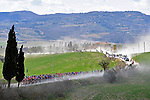 The dust rises during the Strade Bianche 2019 running 184km from Siena to Siena, held over the white gravel roads of Tuscany, Italy. 9th March 2019.<br /> Picture: LaPresse/Fabio Ferrari | Cyclefile<br /> <br /> <br /> All photos usage must carry mandatory copyright credit (© Cyclefile | LaPresse/Fabio Ferrari)