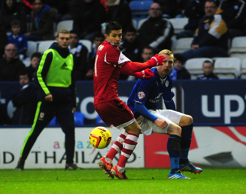 Middlesbrough's Emmanuel Ledesma vies for possession with Leicester City's Ritchie De Laet <br /> <br /> Photo by Chris Vaughan/CameraSport<br /> <br /> Football - The Football League Sky Bet Championship - Leicester City v Middlesbrough - Saturday 25th January 2014 - The King Power Stadium - Leicester<br /> <br /> &copy; CameraSport - 43 Linden Ave. Countesthorpe. Leicester. England. LE8 5PG - Tel: +44 (0) 116 277 4147 - admin@camerasport.com - www.camerasport.com