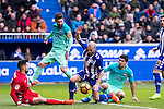 Club Deportivo Alaves'es goalkeeper Fernando Pacheco , defender Victor Laguardia Cisneros competes for the ball with FC Barcelona's forward Leo Messi, forward Luis Suarez  during the match of La Liga between Deportivo Alaves and Futbol Club Barcelona at Mendizorroza Stadium in Vitoria, Spain. February 11, 2017. (ALTERPHOTOS/Rodrigo Jimenez)