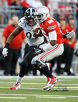 Ohio State Buckeyes quarterback J.T. Barrett (16) rushes upfield past Cincinnati Bearcats defensive lineman Silverberry Mouhon (92) during the second quarter of the NCAA football game against the Cincinnati Bearcats at Ohio Stadium in Columbus on Sept. 27, 2014. (Adam Cairns / The Columbus Dispatch)