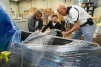 MORRISVILLE, PA -  OCTOBER 11:  From left, School Board member Wanda Kartel, District Safety director Dave May and Borough Council member Dave Rivella unwrap the new equipment donation in the future science lab at Morrisville High School October 11, 2013 in Morrisville, Pennsylvania. The new lab equipment, valued at a quarter million dollars, was donated by Medimmune of Bensalem, Pennsylvania. (Photo by William Thomas Cain/Cain Images)