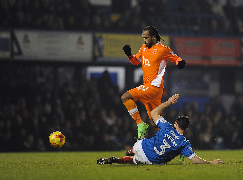 Blackpool's Nathan Delfouneso holds off the challenge from Portsmouth's Enda Stevens<br /> <br /> Photographer Ashley Western/CameraSport<br /> <br /> The EFL Sky Bet League Two - Portsmouth v Blackpool  - Tuesday 14th February 2017 - Fratton Park - Portsmouth<br /> <br /> World Copyright &copy; 2017 CameraSport. All rights reserved. 43 Linden Ave. Countesthorpe. Leicester. England. LE8 5PG - Tel: +44 (0) 116 277 4147 - admin@camerasport.com - www.camerasport.com