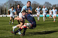 Pat Tapley of Bedford Blues is tackled by Jamie Stevenson of London Scottish on the way to scoring his team's 2nd try of the game during the Greene King IPA Championship match between London Scottish Football Club and Bedford Blues at Richmond Athletic Ground, Richmond, United Kingdom on 25 March 2017. Photo by David Horn / PRiME Media Images.