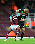 West Ham's Alex Song tussles with Stoke's Geoff Cameron<br /> <br /> Barclays Premier League - West Ham United v Stoke City - Upton Park - England -12th December 2015 - Picture David Klein/Sportimage
