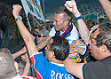 Fernando Ricksen Testimonial :  Fernando Ricksen is mobbed by fans as he takes a lap of honour.