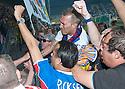 Fernando Ricksen Testimonial :  Fernando Ricksen is mobbed by fans as he takes a lap of honour.