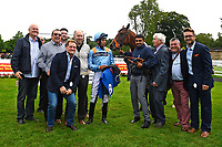 Connections of Move Over celebrate the winning of The M J Church British EBF Novice Stakes (Plus 10) (Div 1), during Afternoon Racing at Salisbury Racecourse on 7th August 2017