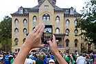 September 10, 2016; A visitor makes a video of the Main Building on a game day. (Photo by Matt Cashore)