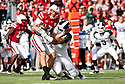 29 October 2011: Taylor Martinez #3 of the Nebraska Cornhuskers sacked by William Gholston #2 of the Michigan State Spartans in the first quarter at Memorial Stadium in Lincoln, Nebraska.  Nebraska defeated Michigan State 24 to 3.