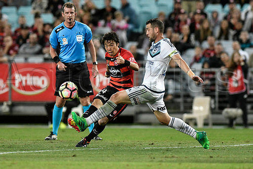 April 8th 2017, ANZ Stadium, Sydney, Australia; A-League football, Western Sydney Wanderers versus Melbourne Victory; Wanderers midfielder Jumpei Kusukami shoots as Victory captain Carl Valeri attempts to block the shot; The match  ended in a 0-0 draw;