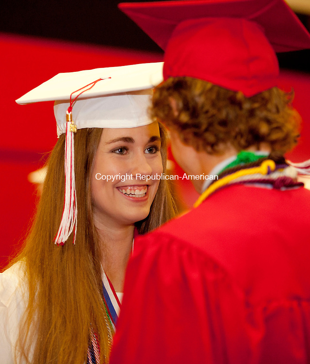 WATERBURY, CT-21 June 2013-062113BF02- Valedictorian Lindsey Bonitz, 18, who will be attending UConn talks with friend Blake Wetmore,17, during graduation at Cheshire High School Friday in Cheshire. Bob Falcetti Republican-American