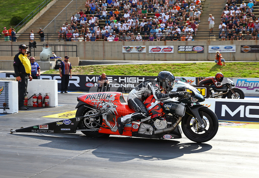 Jul. 19, 2013; Morrison, CO, USA: NHRA pro stock motorcycle rider Shawn Gann during qualifying for the Mile High Nationals at Bandimere Speedway. Mandatory Credit: Mark J. Rebilas-
