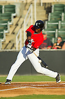 Keon Barnum (35) of the Kannapolis Intimidators makes contact with the baseball against the Greensboro Grasshoppers at CMC-Northeast Stadium on July 15, 2013 in Kannapolis, North Carolina.  The Intimidators defeated the Grasshoppers 4-0.   (Brian Westerholt/Four Seam Images)