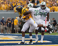 WVU wide receiver Stedman Bailey scores. The WVU Mountaineers beat the Marshall Thundering Herd 34-13 in a game called just after the fourth quarter started because of severe thunderstorms in the area. The game was played at Milan Puskar Stadium in Morgantown, West Virginia on September 4, 2011.