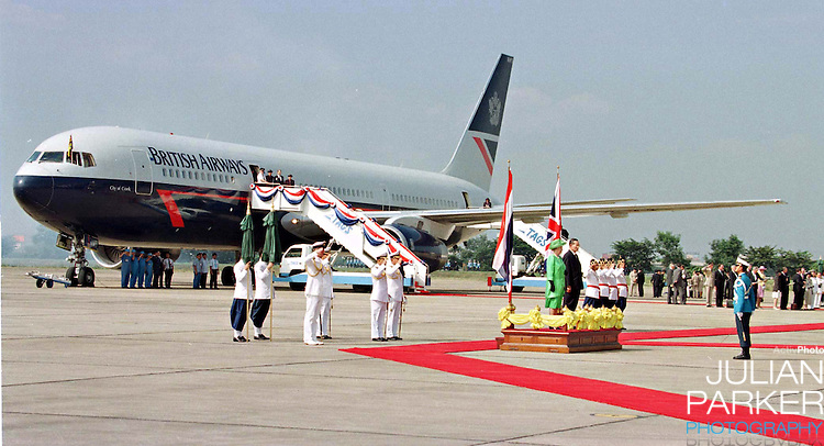 Queen Elizabeth and the Duke of Edinburgh arrive at Don Muang Airport in Bangkok to begin a State visit to Thailand.Queen Elizabeth, and The Duke of Edinburgh are accompanied by King Bhumibol of Thailand, in a traditional welcome
