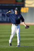 Cedar Rapids Kernels shortstop Ryan Walker (26) warms up before a game against the Quad Cities River Bandits on August 18, 2014 at Perfect Game Field at Veterans Memorial Stadium in Cedar Rapids, Iowa.  Cedar Rapids defeated Quad Cities 4-2.  (Mike Janes/Four Seam Images)