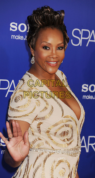 "Vivica A. Fox.arriving at the Los Angeles premiere of ""Sparkle"" at Grauman's Chinese Theatre in Hollywood, California, USA, .August 16th, 2012..half  length cream gold nude dress patterned hand waving .CAP/ROT/TM.©Tony Michaels/Roth Stock/Capital Pictures"
