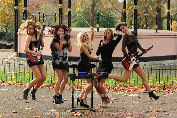 Pop group, The Saturdays pose in Hyde Park to promote the Band Hero game, London. 06/11/2009   Steve Vas / Featureflash
