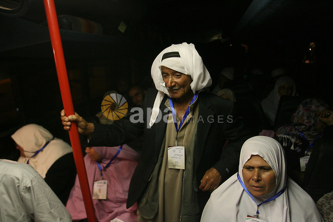 Palestinian pilgrims sit in buses as they wait to cross the Rafah border crossing into Egypt , in the southern Gaza Strip town of Rafah on Oct. 09, 2012 . Hundreds of Palestinian pilgrims crossed into Egypt on their way to Saudi Arabia to perform the annual Muslim Hajj pilgrimage. Photo by Eyad Al Baba