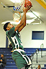 Camren Wynter #12 of Holy Trinity looks to drive to the hoop during a varsity boys' basketball game against Hempstead at Baldwin High School on Tuesday, Dec. 29, 2015. Holy Trinity won by a score of 70-58.
