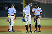Hickory Crawdads third baseman Ti'Quan Forbes (10) celebrates with first baseman Yanio Perez (28) after their win over the Kannapolis Intimidators at Kannapolis Intimidators Stadium on May 18, 2017 in Kannapolis, North Carolina.  The Crawdads defeated the Intimidators 6-4.  (Brian Westerholt/Four Seam Images)