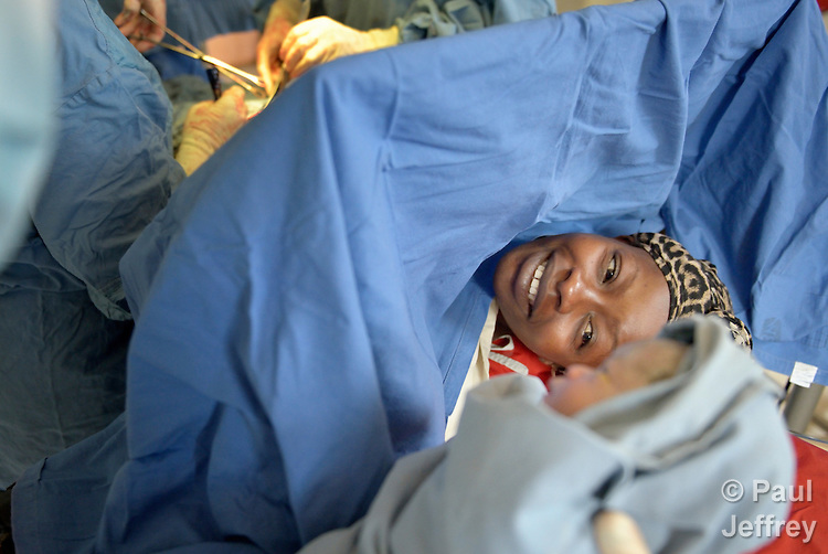 Fatima Nakuyioko takes a look at her baby, moments after it was born via Caesarean section in the St. Daniel Comboni Catholic Hospital in Wau, South Sudan.