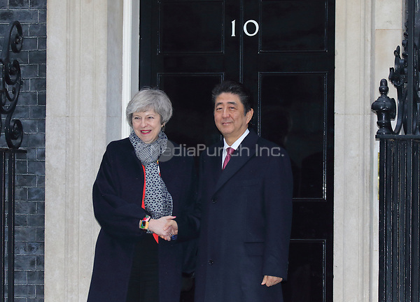 Prime Minister Theresa May and Prime Minister Shinzo Abe of Japan are seen on the steps of 10 Downing Street, London on January 10th 2019<br /> CAP/ROS<br /> &copy;ROS/Capital Pictures /MediaPunch ***NORTH AND SOUTH AMERICAS ONLY***