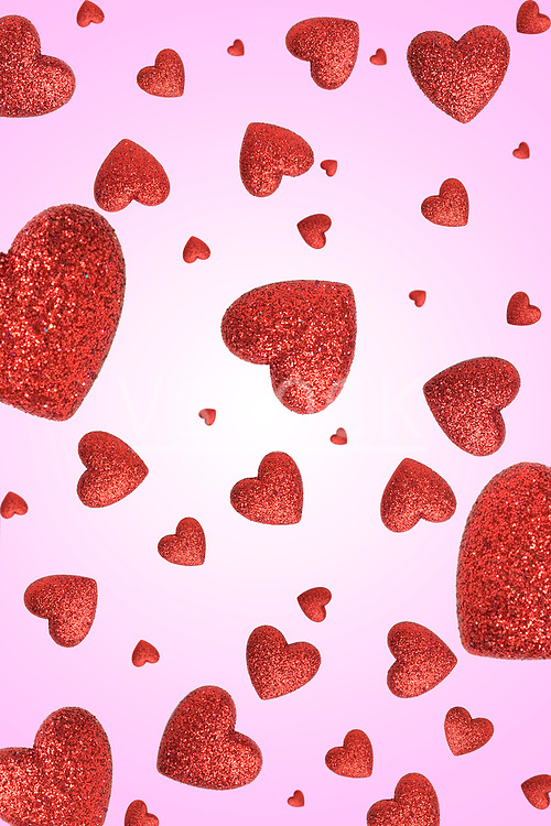 Small red hearts on pink background