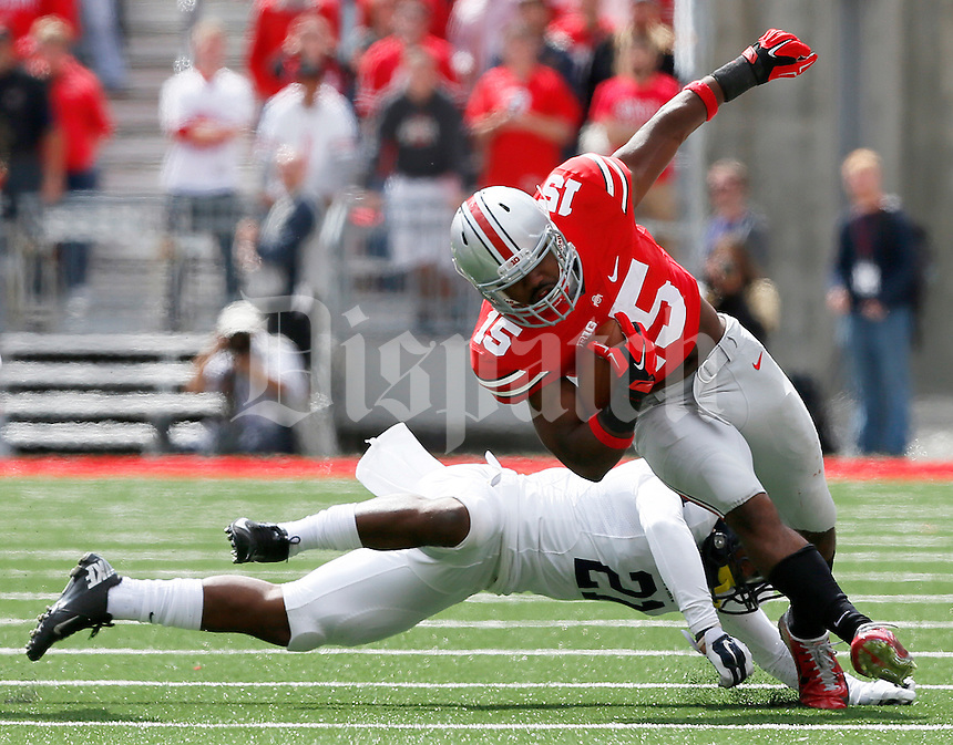 Kent State Golden Flashes cornerback Demetrius Monday (21) is unable to stop Ohio State Buckeyes running back Ezekiel Elliott (15) in the first quarter, at Ohio Stadium in Columbus, Saturday, September 13, 2014. (Dispatch Photo by Jenna Watson)