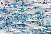 Aerial view of crevasses and aqua water pools in the Miles glacier, Chugach Mountans, southcentral, Alaska.