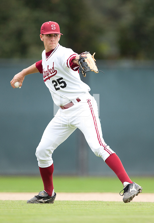 STANFORD, CA - March 27, 2011: Stephen Piscotty of Stanford baseball throws to first after fielding a short grounder during Stanford's game against Long Beach State at Sunken Diamond. Stanford won 6-5.