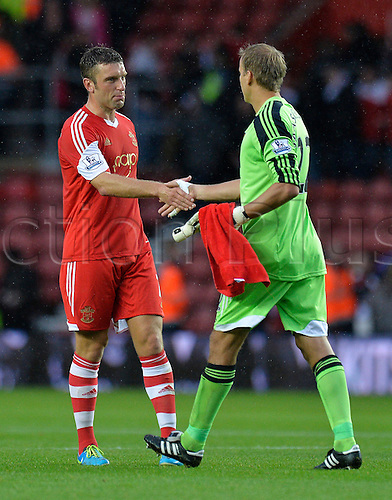 15.09.2013 Southampton, England.   Rickie Lambert of Southampton shakes hands with Jussi Jaaskelainen of West Ham after the Premier League game between Southampton and West Ham United from St Mary's Stadium.