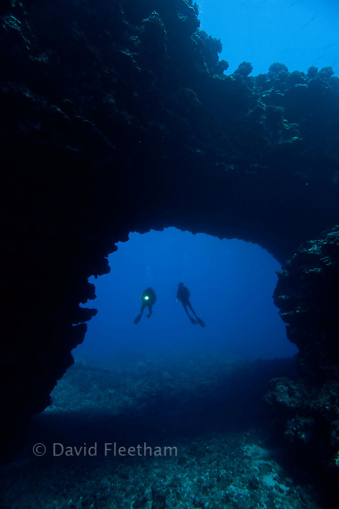 Divers (MR) pictured at an archway outside of First Cathedral off the Island of Lanai, Hawaii.