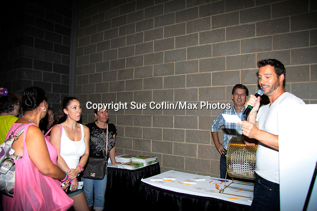 """Days of Our Lives Eric Martsolf """"Brady Black"""" appears at the 12th Annual Comcast Women's Expo on September 7 (also 6th), 2014 at the Connecticut Convention Center, Hartford, CT announced raffle winners. (Photo by Sue Coflin/Max Photos)"""