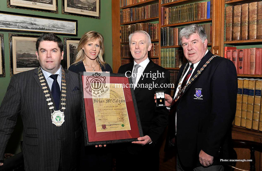 Brian McColgan receives the Order of Innisfallen award for his contribution to tourism in Killarney from Tom Randles, President, Killarney Chamber of Tourism and Commerce, left and Killarney Mayor Sean Counihan at a special function in Muckross House, Killarney. Also in picture is Marina McColgan..Picture by Don MacMonagle...pr pic from KCTC