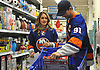 "John Tavares, New York Islanders captain, and Aryne Fuller fill their cart with presents at Toys ""R"" Us in Carle Place during the team's holiday shopping for children in hospitals on Thursday, Nov. 30, 2017. The gifts will be hand-delivered to children in eight local hospitals by the players on Monday, Dec. 18."