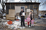 Vita Stankovic and his wife Sofija Arbanac, along with their daughters Rada, 5, and Caka, 3, stand outside their meager home in an illegal Roma settlement in Belgrade, Serbia. In February 2012, the family received the letter that Stankovic is holding informing them they will be evicted by city officials in March 2012 to make way for new high-rise office buildings.  In April 2012, the Serbian Orthodox family was forcibly evicted from the city center and given a metal shipping container in Makis, at the edge of Belgrade, where they could live. After several weeks, they were evicted from the shipping container because of Stankovic's repeated fights with his neighbors, and at the end of 2012 lived in an informal Roma squatter settlement in nearby Palilula. In 2009, they had been evicted from another settlement in Belgrade..