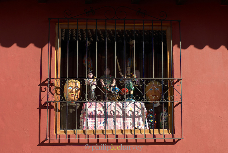 Statues and masks for sale in a shop in Antigua, a UNESCO World Heritage Site in Guatemala
